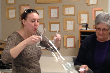 Student instructor experiments with blowing bubbles.